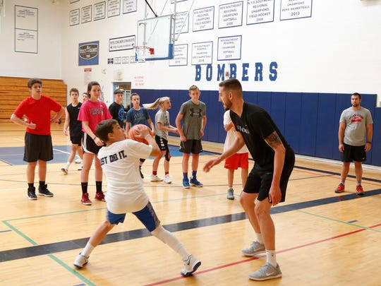 Tyler Lydon covers camper, Gavyn Queen, during the inaugural Tyler Lydon Dream Big Basketball Camp at Stissing Mountain High School on Tuesday.