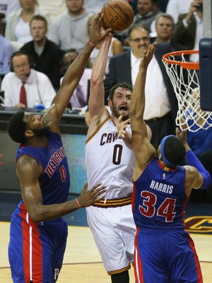 Pistons center Andre Drummond blocks a shot by Cavaliers forward Kevin Love during the fourth period  of the Pistons' Game 2 loss Wednesday in Cleveland.