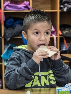 Post-Franklin second grader David Leon Valadez enjoys a Kellogg Pop-Tart during a relaunch of their breakfast program on Friday.