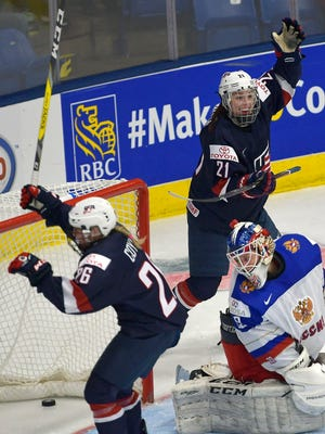 The United State's Kendall Coyne (26) and Hilary Knight (21) celebrate a third-period goal against Russia goaltender Maria Sorokina at the 2017 IIHF women's world championship in Plymouth, Mich., on Saturday, April 1.