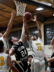 Delone Catholic's Jared Murren and York Catholic's Eric Phelps fight for the rebound in the second half of a YAIAA boys basketball game Friday, Jan. 5, 2018, at York Catholic. York Catholic defeated Delone Catholic 70-36.
