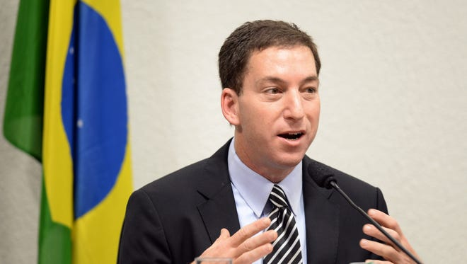 The Guardian's Brazil-based reporter Glenn Greenwald, who was among the first to reveal Washington's vast electronic surveillance program testifies before  the investigative committee of the Senate that examines charges of espionage by the United States  in Brasilia on Octuber 9, 2013, following press reports of US electronic surveillance in Brazil based on leaks from Edward Snowden, a former US National Security Agency contractor. AFP PHOTO/Evaristo SaEVARISTO SA/AFP/Getty Images ORIG FILE ID: 523649786