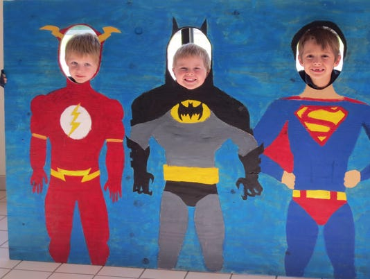 clay, chase, canton, caitlin Oelke siblings in superhero cut out