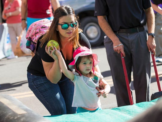 Abby Copp from Tucson helps her daughter, Sophia, 3,