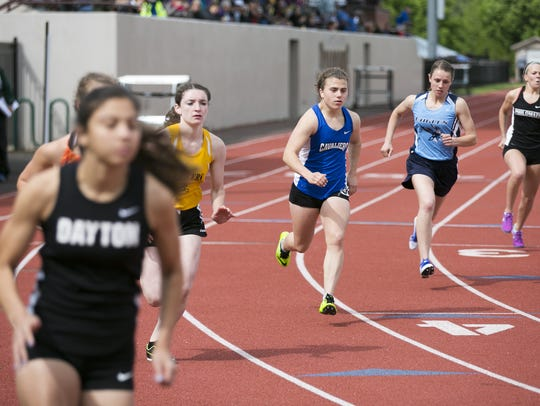 Blanchet Catholic's Emily Collier (center) starts the