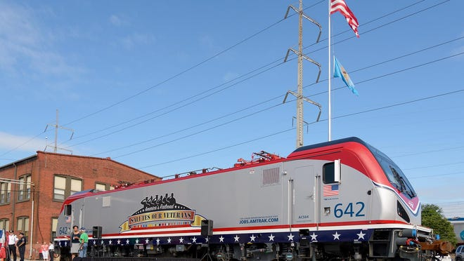 An Old Glory-colored locomotive was unveiled in a ceremony Monday in Wilmington.