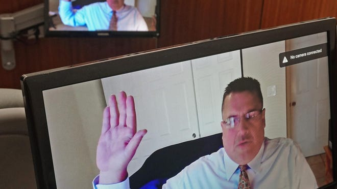Jeff Britt appears from his home in Palm Beach, Florida, during a hearing before Judge Daniel A. Procaccini in July.
