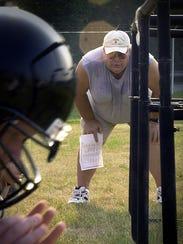 Brad Livingston watches his lineman run through drills