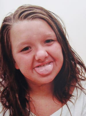This undated photo provided by Tammy Weeks shows her daughter, Nicole Lovell, posing when she was 10 in Blacksburg, Va. The 13-year-old girl was found dead just across the state line in Surry County, N.C., and two Virginia Tech students are charged in the case.