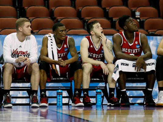 North Carolina State players watch from the bench during the final minutes of an NCAA men's college basketball tournament first-round game against Seton Hall on Thursday, March 15, 2018, in Wichita, Kan. Seton Hall won 94-83. (AP Photo/Charlie Riedel)