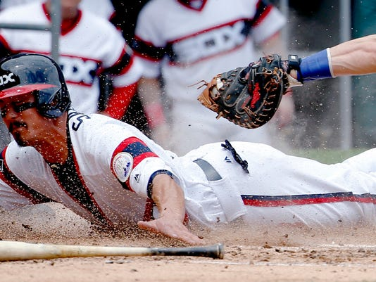 FILE - In this June 26, 2016, file photo, Chicago White Sox's Tyler Saladino, left, scores on a sacrifice bunt by Adam Eaton as Toronto Blue Jays catcher Russell Martin applies a late tag during the third inning of a baseball game in Chicago. Sacrifice bunts are down 37 percent in 10 years and expectations are they'll continue to slide.  (AP Photo/Nam Y. Huh, File)