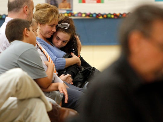 Brianna Smith gets a hug from mom Nadine after getting knocked out of the Lee County Middle School Spelling Bee Thursday, March 19 in Fort Myers.