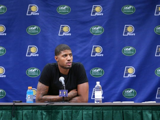 Indiana Pacers forward Paul George fields questions from the media about his accident, recovery and his future with the Pacers during a press conference held at Bankers Life Fieldhouse on Friday, August 15, 2014.