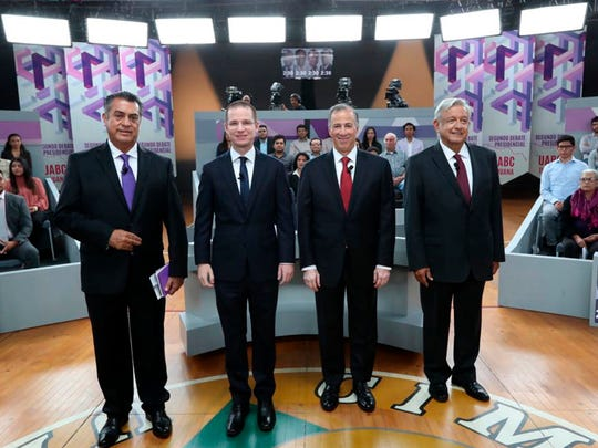"In this photo released by the National Electoral Institute (INE), presidential candidates, from left, independent Jaime Rodriguez, known as ""El Bronco,"" Ricardo Anaya of the Forward for Mexico Coalition, Jose Antonio Meade, of the Institutional Revolutionary Party, and Andres Manuel Lopez Obrador, with the MORENA party, attend the second of three debates in Tijuana, Mexico, Sunday, May 20, 2018. Mexico will hold general elections on July 1. (INE via AP)"
