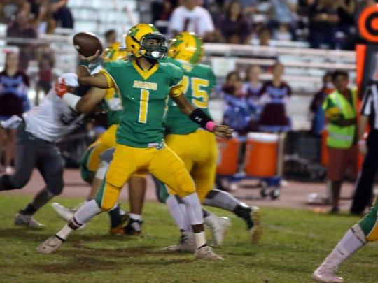 Coachella Valley quarterback Armando Deniz in action against Rancho Mirage on Friday, October 6, 2017 in Thermal.