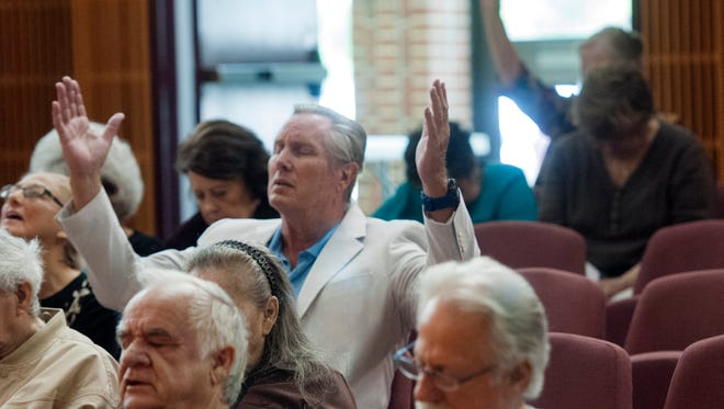 Chris Dodds joins the local observance of the National Day of Prayer at Pensacola City Hall on May 4, 2017.