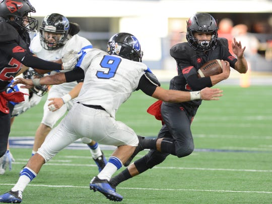 Strawn running back Julian Fraga tries to get around
