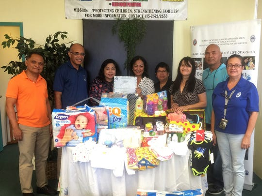In conjunction with Foster Children's Month, ACTS 2 Church received a certificate award from the Bureau of Social Services Administration for donating various supplies for infants and children on May 24, 2018.  Pictured from left: Pastor Alex Soto, Maika Vuki, Arlene Gadia BOSSA supervisor, Toni Quitugua, Annie Soto, Kim Bersamin, Alejo Sablan and Arlene Santos BOSSA supervisor.