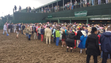 A muddy infield at the 143rd Kentucky Derby