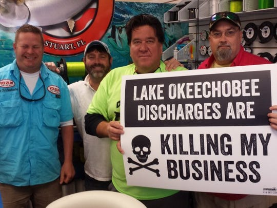 Chris Sharp (left) of Beachwalker Guide Service; Tim Goodwin, maker of T & A Jigs; Bruce Hrobak, owner of Billy Bones Bait and Tackle; and Tim Kenney, owner of Tackle for Less represent a group of small business owners who are being destroyed during the tourist season by foul water discharges coming from Lake Okeechobee. (ED KILLER/TREASURE COAST NEWSPAPERS)