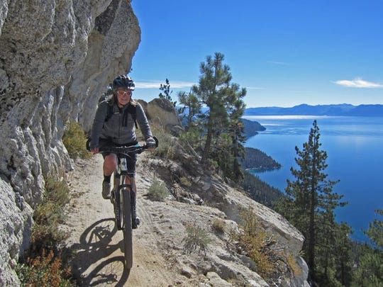 Lana Corless of Incline Village riding the Flume Trail overlooking Lake Tahoe. The trail, just a short drive from Reno, is considered among the most scenic in the western United States.