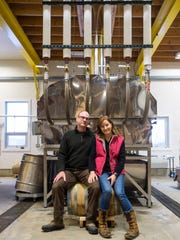 Eric and Laura Sorkin in front of one of their evaporators