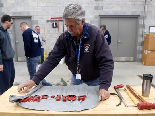 Ray Kinsey, chief of the York County Hazardous Materials Response Team, lays out all of the tools in a chlorine institute emergency kit during a recent simulated leak training.