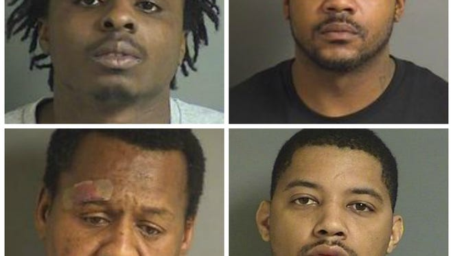 From top left, Quentin D.W. Eatman, 24, of Chicago; Kwain E. Crawford, 35, of Chicago; Milton Whitehead, 50, of Cedar Rapids; Curtis J. Johnson, 29, of Iowa City.