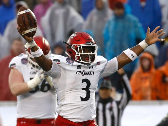 Cincinnati running back Michael Warren II celebrates after scoring a touchdown in the second half of the Military Bowl NCAA college football game against Virginia Tech, Monday, Dec. 31, 2018, in Annapolis, Md. Cincinnati won 35-31. (AP Photo/Patrick Semansky)
