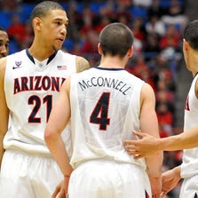 Arizona Wildcats forward Rondae Hollis-Jefferson (23) forward Brandon Ashley (21) guard T.J. McConnell (4) and guard Nick Johnson (13) huddle up during the second half against the Colorado Buffaloes at McKale Center.