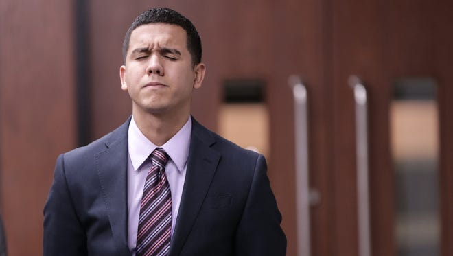 Jan Michael Nieves Delgado reacts after hearing a guilty verdict from the clerk after it was originally read as not guilty Thursday in the 168th District Court. Delgado is a former Fort Bliss soldier convicted in the deaths of two highway workers in 2014 after he drove through a construction barricade on Interstate 10 East.