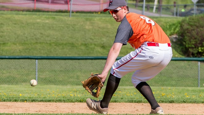 Champlain Valley sophomore Storm Rushford fields a ground ball during warm-ups before Thursday's baseball game against Essex in Hinesburg. Rushford was diagnosed with leukemia last summer.