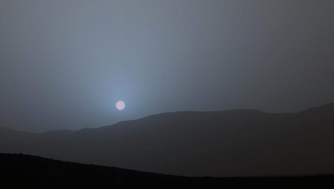 Stunning images captured by NASA's Curiosity Mars rover show a Martian sunset is actually blue.