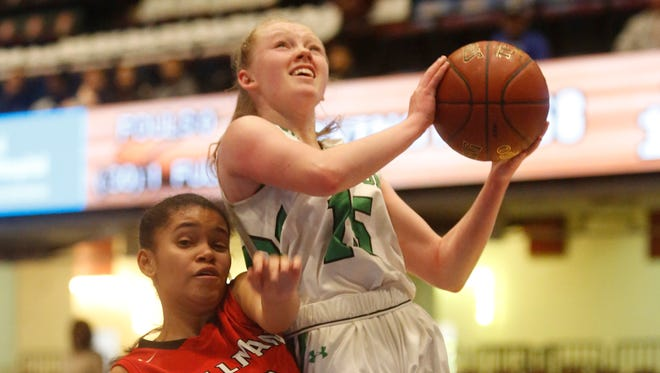 Irvington's Lindsay Halpin (15) is fouled by Spellman's Brianna Diaz (20) during the consolation game at the18th Annual Slam Dunk Tournament at the Westchester County Center in White Plains on Dec. 27, 2016.   Irvington won 77-63.