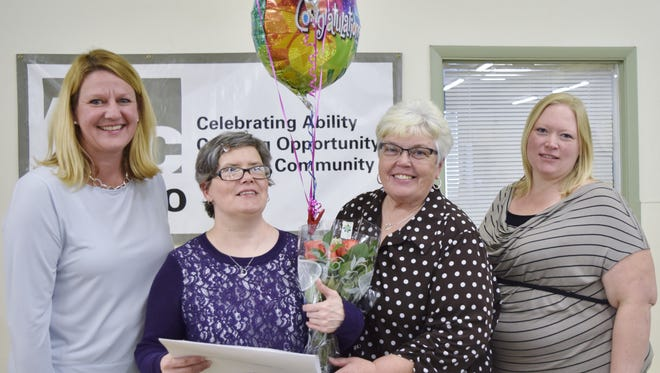 Jeanne  Hansen (in purple) celebrates her receipt of the Outstanding Performance Award from the New York State Industry for the Disabled.