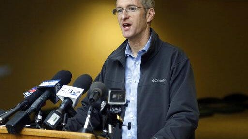 Portland Mayor Ted Wheeler speaks during a news conference in Portland.