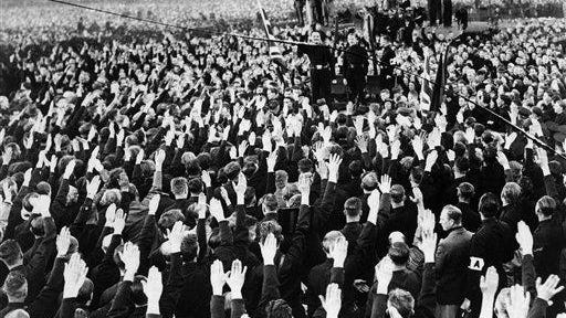 A general view of the great fascist meeting in Hyde Park, London, United Kingdom on Sunday, Sept. 9, 1934. Sir Oswald Mosley is seen in the center making his speech, with huge crowds all around saluting him.