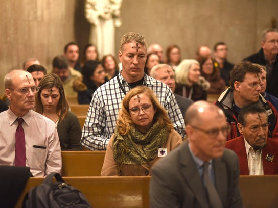 Parishioners sit in prayer during Ash Wednesday Mass