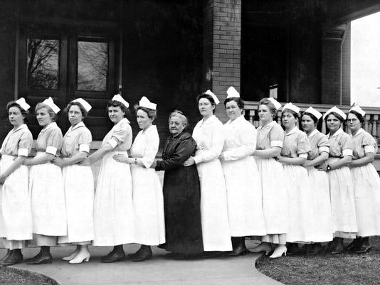636136785145930219-Ellen-Burge-with-nurses.jpg
