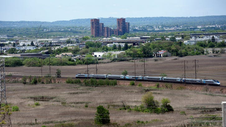 An Amtrak Acela train travels the two-track Northeast Corridor through the Meadowlands.