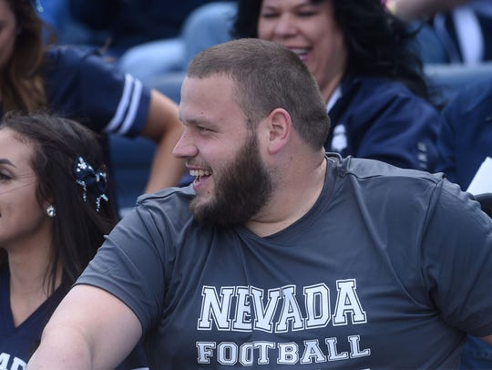 Ex-Nevada football player Joel Bitonio sits with friends