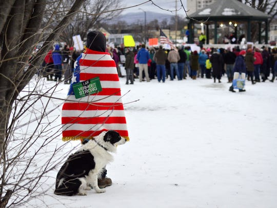 Jill Adams of Londonderry and her dog, Jed, watch a