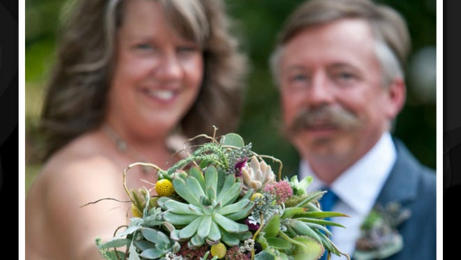 Evelyn Taylor Bonner and Chris Bonner incorporated succulents into Evelyn's wedding bouquet and Chris' boutonniere. The Collingswood couple, both artists, share studio space in their home.