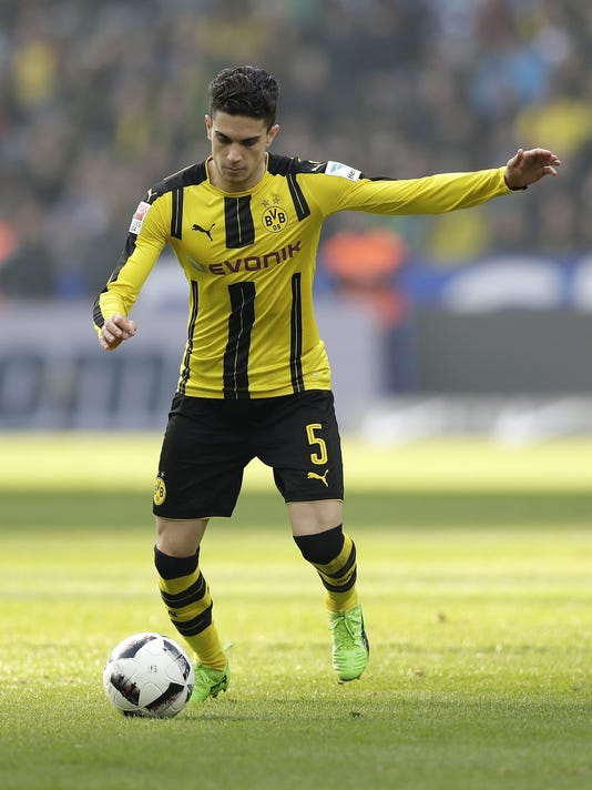 """FILE - In this March 11, 2017 file photo Dortmund's Marc Bartra plays the ball during the German Bundesliga soccer match between Hertha BSC Berlin and Borussia Dortmund in Berlin, Germany. Spanish defender Bartra is leaving Borussia Dortmund to join La Liga side Real Betis. Dortmund says it has made a """"big concession"""" on the transfer fee to allow Bartra return to Spain after what has been a tumultuous one and half Bundesliga seasons. (AP Photo/Michael Sohn, file)"""
