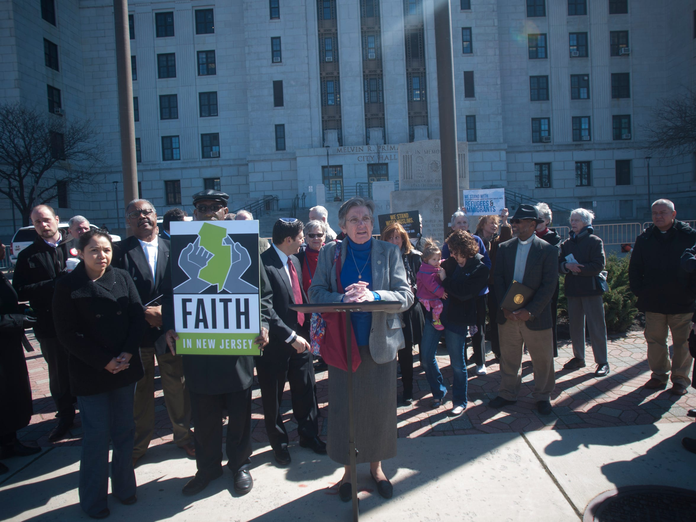 Sister Veronica Roche, speaks during an rally on undocumented