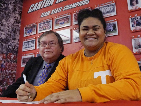 Canton's state champion in shot put, Emily Meier, signs with the University of Tennessee. There for the moment is her father, Richard Meier.