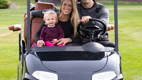 Jessica and Kevin Lynch, seen here with daughter...