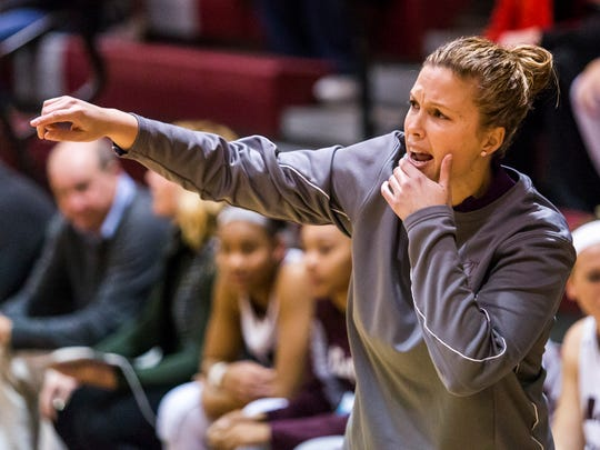 Caravel head coach Kristin Caldwell gives instructions to her team in the first quarter of Concord's 59-48 win over over Caravel at Caravel Academy on Monday night.