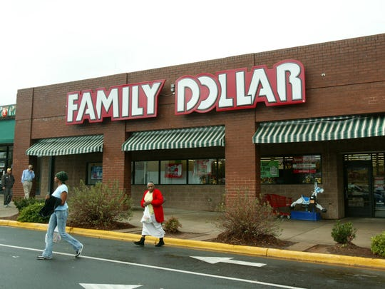 Customers walk past a Family Dollar store at Hickory Grove Market in Charlotte, N.C. Dollar Tree is buying rival discount store Family Dollar in a cash-and-stock deal valued at about $8.5 billion, the companies announced.