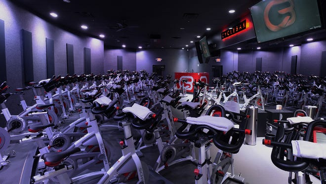 A stock photo of the inside of the CycleTheater at CycleBar studio.